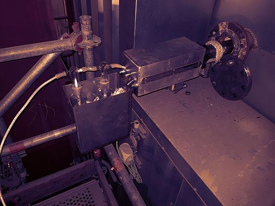 Measurement of acidic gases (HCl, HBr) at 400°C.
